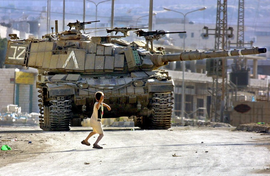 palestinian-child-throwing-rock-at-israeli-tank-photo-by-musa-AL-SHAER.jpg