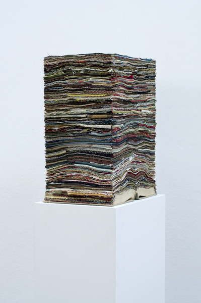 Benjamin Callan, The Loom (2013). Paper and fabric.  The loom is the tool that the tapissière, the tapestry-maker or fabricator/storyteller, uses to  narrate their story. Whether it's prophetic or historical (like the use of tapestries in medieval times) or simply fictional/allegorical (the Unicorn Tapestries are an excellent example). What this means for books is relatively the same. Again, a monolith is constructed here to give books a sense of monumental importance, a sense of real weight that they must carry. The words are manifested here by layers of fabric because they too have weight. Even if that weight isn't physically felt by us, it is felt by the book carrying those words.  Key themes: Materiality (of books), language, minimalism, monuments