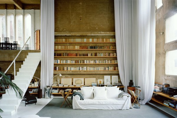 in-the-living-room-ethereal-white-curtains-soften-the-severity-of-the-concrete-walls.jpg
