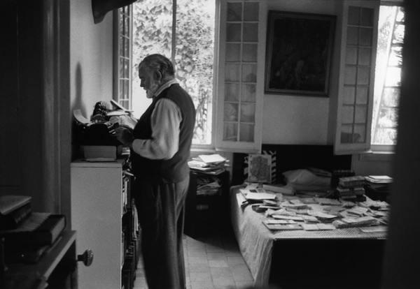 "Ernest Hemingway at his standing ""desk"""