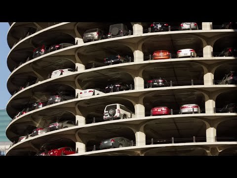 How do you park at Marina City? Architect Bertrand Goldberg showcased the cars of the residents of Marina City by incorporating 19-story ramped parking garages at the base of each tower. Valets use a manlift to maneuver between the 19 floors, to park and retrieve cars of residents.