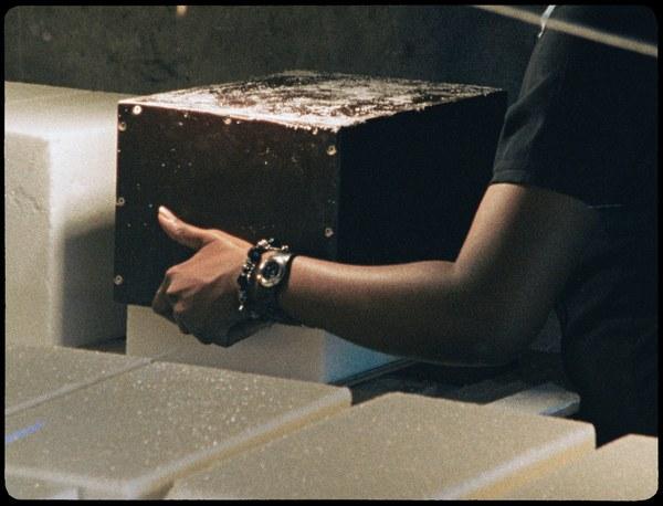 LONNIE VAN BRUMMELEN & SIEBREN DE HAAN, Monument of Sugar - how to use artistic means to elude trade barriers  16mm film essay, silent, colour, 67 min., 304 sugar blocks, 2007