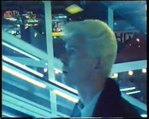 David Bowie on a escalator ride in Singapore