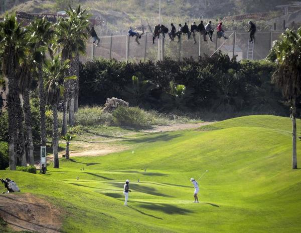 golfer-african-migrants.jpg?format=1000w