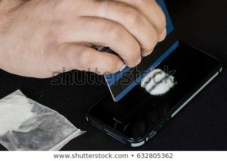addict-uses-drugs-using-mobile-450w-632805362.jpg