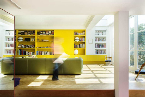 minimalist-yellow-living-room-with-yellow-storage-panels-combine-white-wall-and-ceiling.jpg