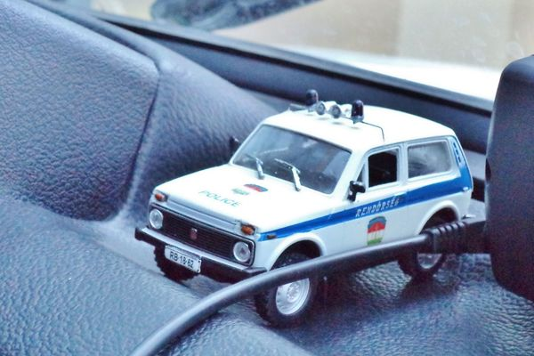 Lada Niva Police car maket in a police car