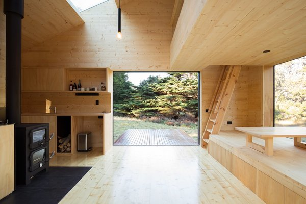 the-open-plan-interior-has-been-sheathed-in-light-colored-wood-to-create-a-sense-of-enclosure-as-well-as-an-escape-from-the-...