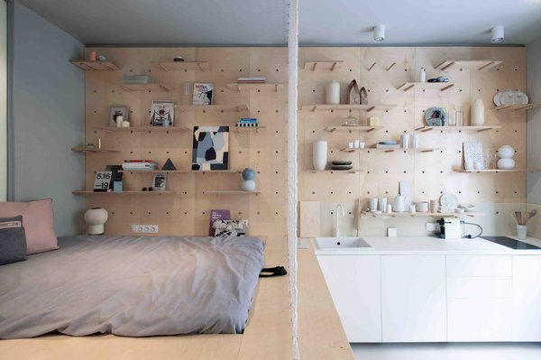 budapest-design-studio-position-collective-employs-clever-storage-solutions-including-a-wardrobe-rack-modular-walls-and-a-st...