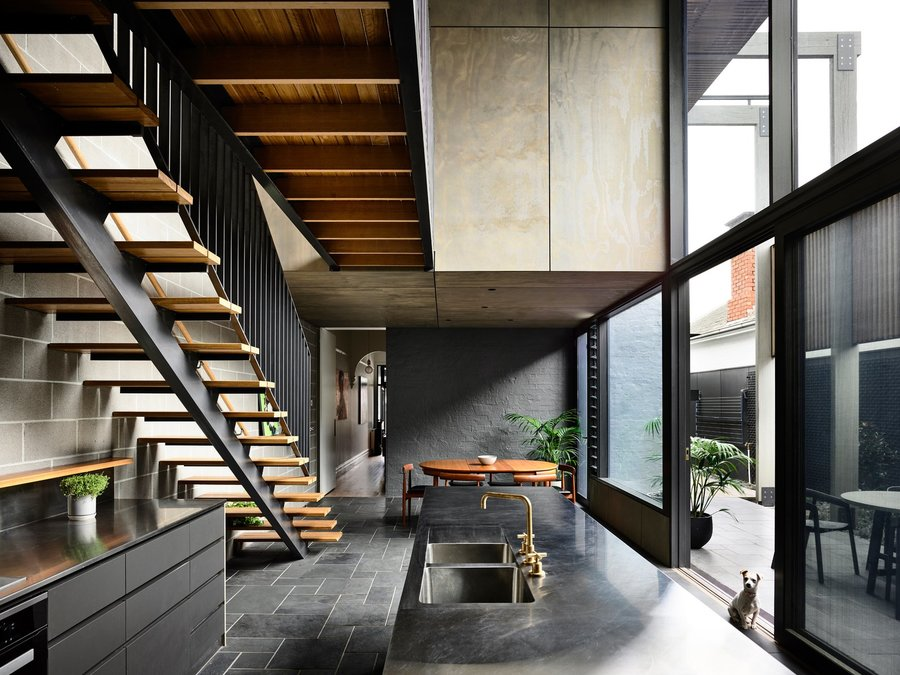 a-catwalk-connects-the-two-bedrooms-upstairs-without-impeding-the-flow-of-light-in-the-main-area-the-staircase-is-composed-o...