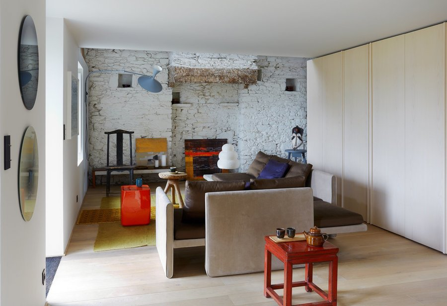 the-row-of-storage-continues-into-the-living-area-the-sofa-and-ceramic-coffee-table-are-both-from-french-designer-christophe...