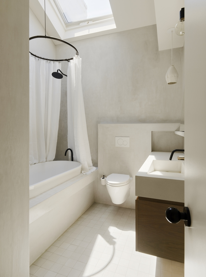 white-concrete-finish-bathroom-with-skylight-brooklyn-1466x1965.jpg