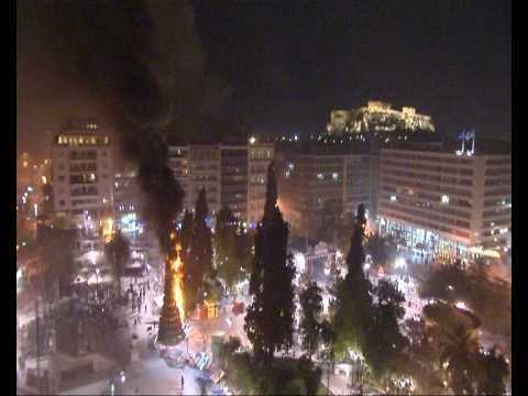 burning christmas tree in athens