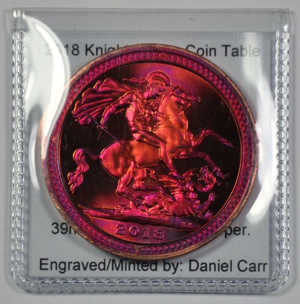 Source:  https://www.ebay.com/itm/2018-Daniel-Carr-KOTCT-St-George-the-Dragon-Color-Toned-Copper-39mm/233126022828?hash=item364764ceac:g:~fwAAOSwg1JcL6wL:rk:17:pf:0