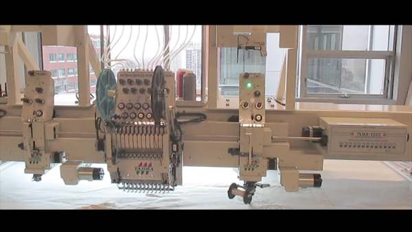 The Tajima Laying Machine
