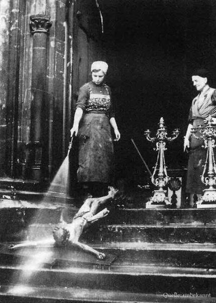 Cleaning Woman Washing a Crucifix
