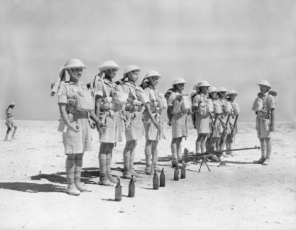 Indian_troops_in_North_Africa_parade_with_a_Boys_anti-tank_rifle_and_-Molotov_cocktail-_petrol_bombs-_6_October_1940._E699.jpg