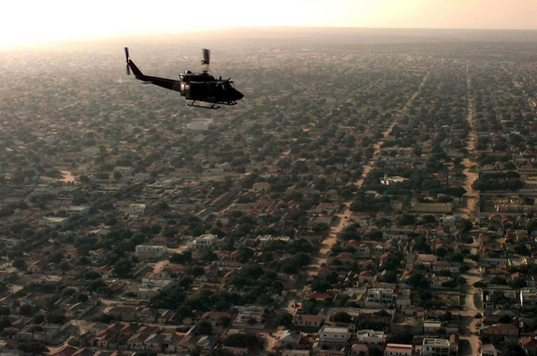aerial_view_of_a_us_helicopter_as_it_flies_over_a_mogadishu_residential_area.jpeg