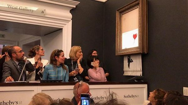 "Banksy's self-shredding painting ""Girl with balloon"" viral Instagram video (2018)"