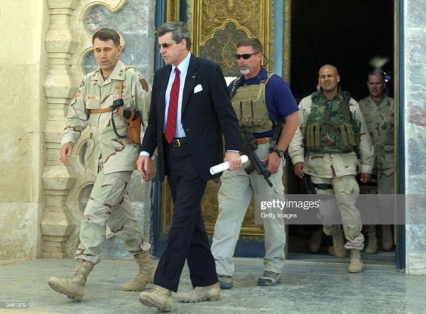 administrator-for-iraq-l-paul-bremer-leaves-a-palace-of-toppled-picture-id3461379