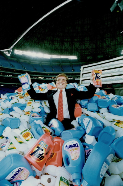 Waste not: Douglas Grindstaff on the SkyDome field, amid discarded plastic bottles. Right, he shows how they can be refilled.