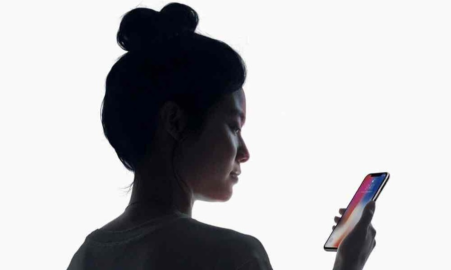 Woman looking at iPhone X