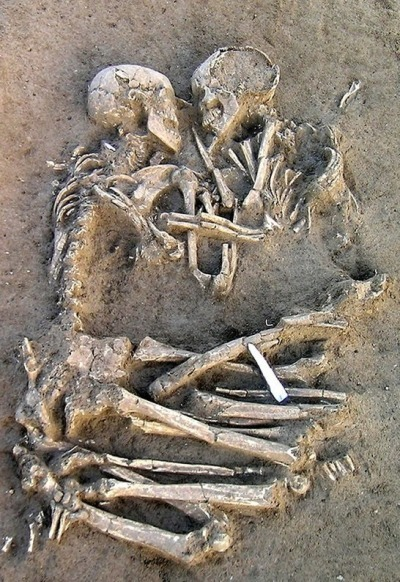 The Lovers of Valdaro are a 6,000 year old Neolithic skeleton couple who were found buried together in Mantua, Italy.    They were both around 20, both 5′2, and had no physical trauma evident in their bones. They were buried with flint tools. Their limbs are entwined in an endless embrace.