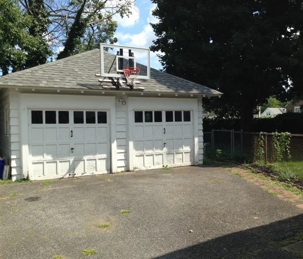 roof-mounted-basketball-goal-white-garage-222-source.jpg