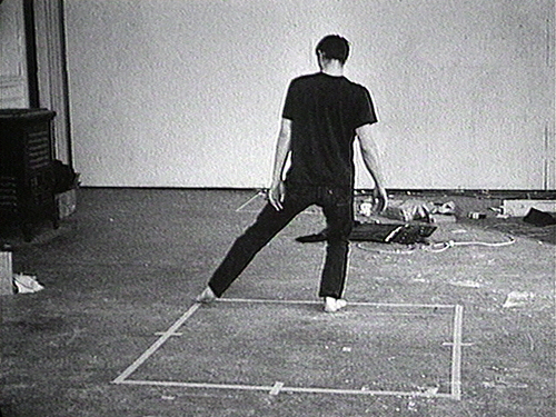 1967-68, 8:24 min, b&w, sound, 16 mm film on video  For this film, Nauman made a square of masking tape on the studio floor, with each side marked at its halfway point. To the sound of a metronome and beginning at one corner, he methodically moves around the perimeter of the square, sometimes facing into its interior, sometimes out. Each pace is the equivalent of half the length of a side of the taped square.     (EAI)