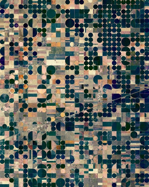 """""""Pivot irrigation fields cover the landscape north of Copeland, Kansas, USA. Powered by electric motors, lines of sprinklers rotate 360 degrees to evenly irrigate crops."""""""