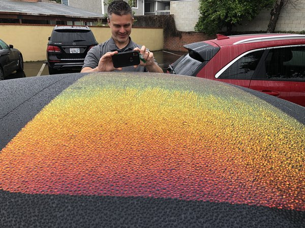Photo of fantastic visual effect from water on car roof (and of Chris Long taking a photo of the same) by David Theriault