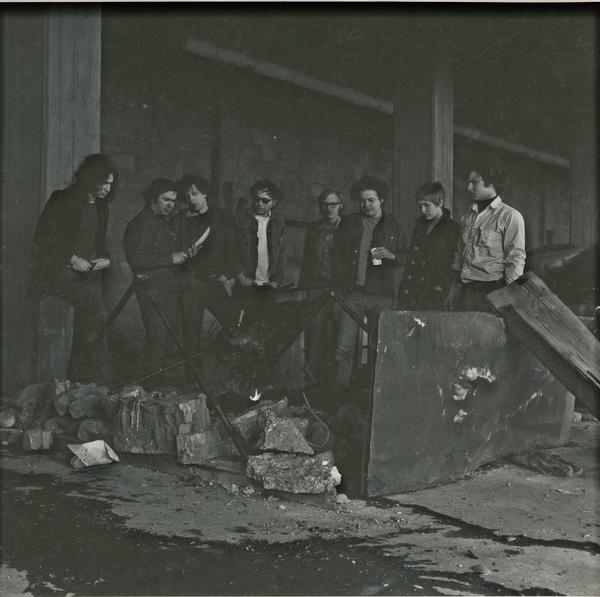 Pig Roast Party (from left to right): Lee Jaffe, Dickie Landry, Phillip Glass, Lee Brewer, unknown, Robert Prado, Robert Prado's wife, Gordon Matta- Clark