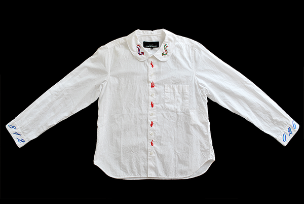 embroidered collar, cuffs, and button strip
