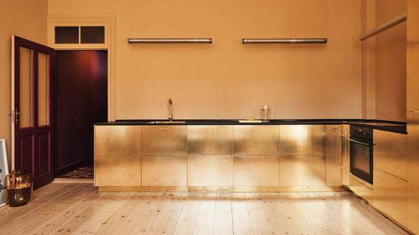 stine-goya-reform-interiors-offices-kitchens-gold-denmark-copenhagen_dezeen_hero-1.jpg