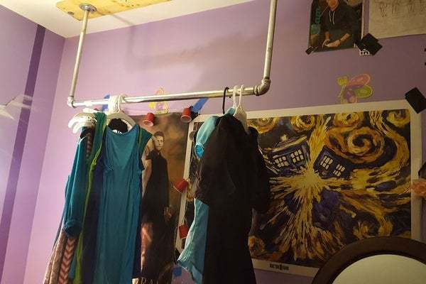 clothing rack from the ceiling