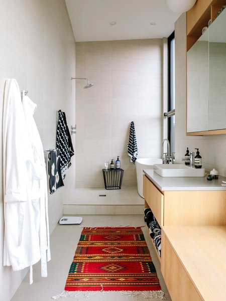 the-master-bathroom-features-a-vox-sink-by-kohler-outfitted-with-an-essence-faucet-by-grohe-marimekko-towels-hang-from-the-w...