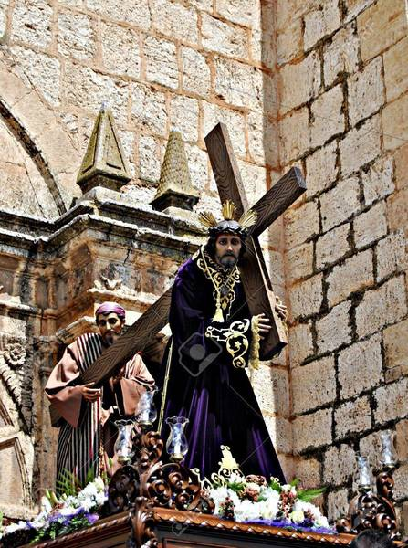 12013554-jesus-carrying-the-cross-during-a-procession-of-holy-week-in-spain.jpg