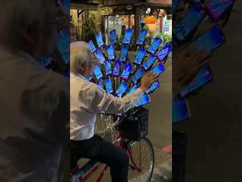 30 phones on his bike to play Pokemon Go