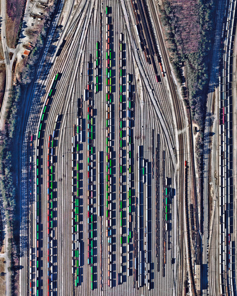 """""""Freight train cars, casting long shadows, are seen in at Inman Yard in Atlanta, Georgia, USA. The facility is operated by Norfolk Southern and serves as one of the major freight hubs on its network that extends for more than 36,000 miles (57,936 km) in the United States."""""""