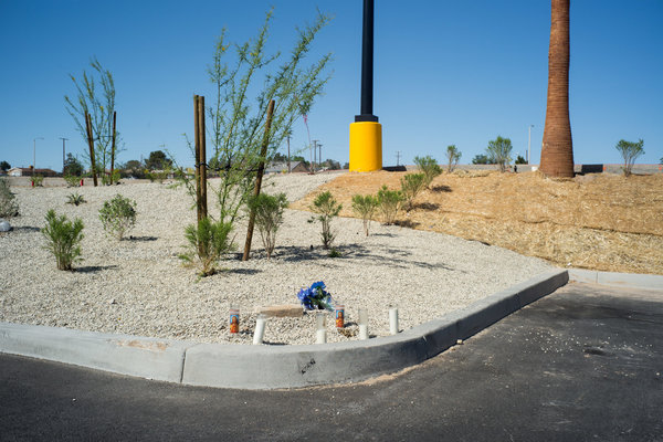 Makeshift memorial for woman shot in the parking lot of a Walmart, 2018. Barstow, CA. James Tensuan