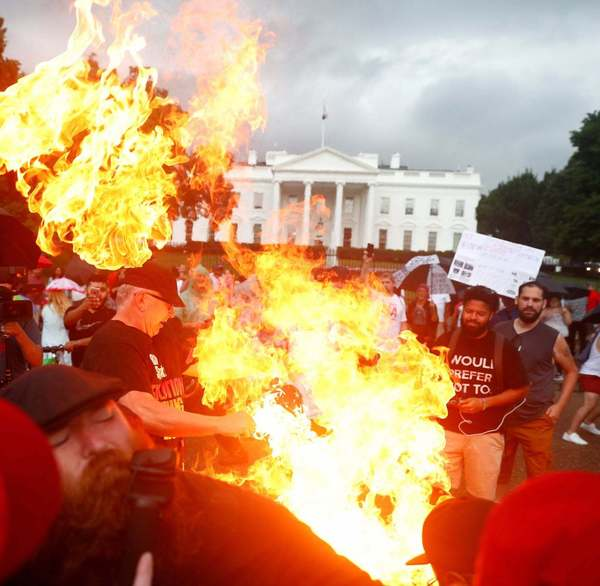 Protesters clash after American flag burned outside White House before Trump's July 4th event