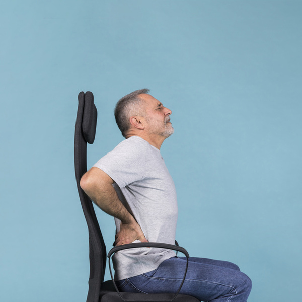 senior-man-sitting-chair-having-back-pain-blue-background_23-2148032394.jpg