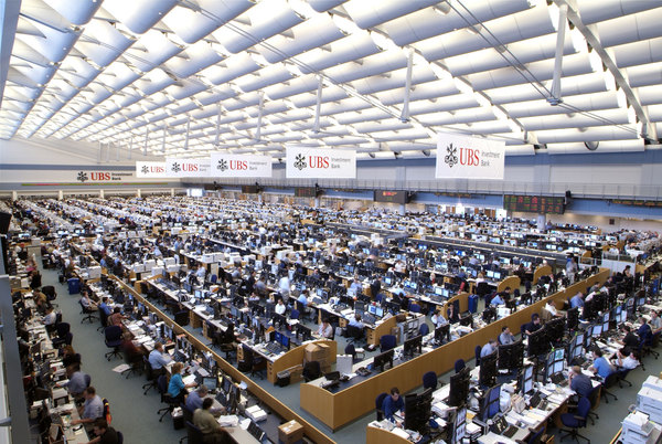 The world's largest trading floor, reminiscent of Mies' Chicago Convention Hall scheme.