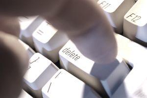 finger-pressing-delete-key-on-computer-keyboard-close-up-la3817-002-5747514e3df78ccee18e3c42.jpg