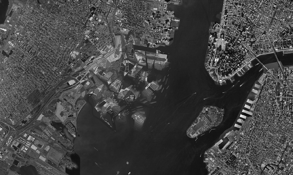 """To prevent the site, which contains Liberty State Park, Ellis Island and the Statue of Liberty, from disappearing, the project creates a landscape defined by water.  To change the hard edge of the site into a softer one, the existing landfill is sculpted into four """"fingers"""" that extend into the harbour.  An increased coastline (it was a mere 5 miles, now it becomes 45) allows for a variety of possibilities for future uses.  The program distributed among the fingers works with land and water to serve a dual purpose.  Thus, the project becomes a hybrid land/seascape that ties the land and the water together."""