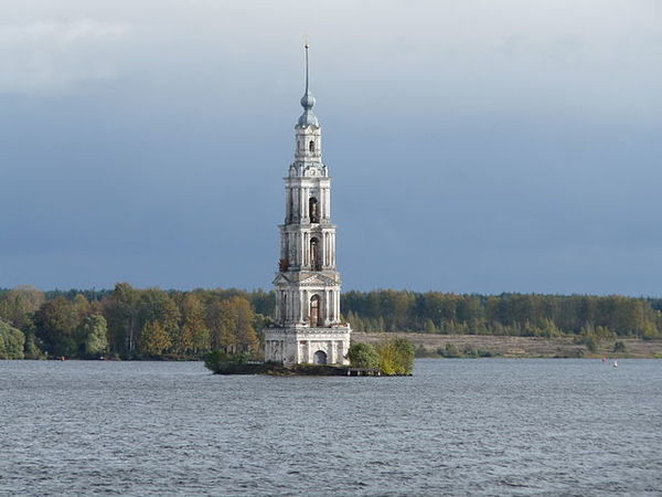 Source: A. Volykhov, http://upload.wikimedia.org/wikipedia/commons/1/13/Bell_tower_in_Kalyazin.jpg. Used under GNU Free Documentation License, Version 1.2.  When reservoirs are created, they come at a cost that isn't just natural and environmental, but social and cultural as well, especially in areas where settlement is well-established. The landscape is irreparably altered. Because of the fluctuations inherent in reservoir due to the controlled storage and release of water, remnants of the previous landscape occasionally re-emerge to remind us of its existence: a building foundation, an old roadbed, old artefacts buried seasonally by water. In most modern projects, the reservoir bed is cleared away prior to dam construction. In other cases, it isn't cleared, and everything is swallowed by the rising waters as it stands. Such was the case in 1939 when Stalin ordered the construction of a hydroelectric reservoir on the Volga River, one of what would be many on a river that soon became essentially a chain of man-made lakes. Among the towns swallowed in part or in whole by the new Uglich Reservoir was the old city of Kalyazin. Dating back at least to the 12th century, the city contained many impressive structures of historical value (some of which escaped the flood and are still in use today).The most prominent of these was the Saint Nicholas (Russian Orthodox) Church, constructed in 1696. The church is the most recent edifice on a site, Nikolo-Zhabensky (St. Nicholas-on-Zhabna) that had been in religious use as a monastery since the 11th century.