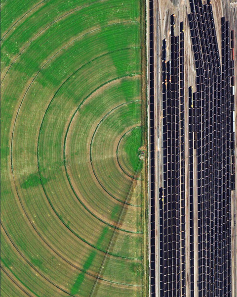 """""""Coal trains — some full, others empty — idle in a railyard next to a pivot irrigation circle in Alliance, Nebraska, USA. The city is located in the Powder River Basin — one of the world's largest coal-mining areas — and serves as a stopping point for trains en route to power plants in the Midwest and Southern parts of the country."""""""