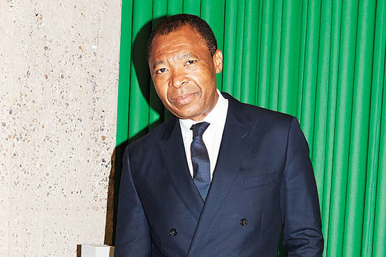 """Next year, the Nigerian-born curator and writer will become the first African director of the Venice Biennale, where he'll continue his career-long project of challenging the status quo """"A as in AQUA, O as in orange, L as in lemon,"""" says the Nigerian-born museum director, curator and art critic Okwui Enwezor, talking into one of his two cell phones on the terrace of a hotel in Venice, Italy."""