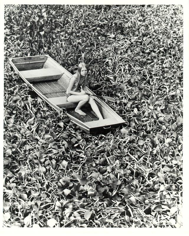 girl_stranded_in_hyacinth_patch_1972.jpg