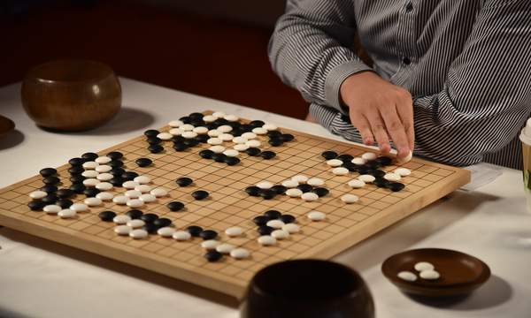 A grandmaster plays AlphaGo at the ancient Chinese game of go
